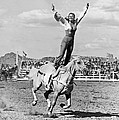 A Trickriding Cowgirl by Underwood Archives