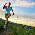A Woman Trail Running Near Boulder, Co by Celin Serbo