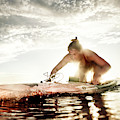 A Young Woman Paddling Hard by Kevin Steele