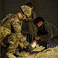 Airman Provides Medical Aid To A Local by Stocktrek Images
