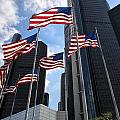 American Flags In Front Of The Detroit Renaissance Center by Gej Jones