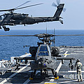 An Army Ah-64d Apache Helicopter Takes by Stocktrek Images