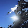 An Extreme Skier Jumps Off A Snowy by Jeff Diener