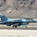 An F-16c Aggressor Jet Landing by Riccardo Niccoli