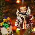 Angel Christmas Ornament by Oscar Gutierrez