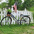 Bicycle And White Fence by Jack Schultz