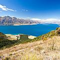 Blue Surface Of Lake Hawea In Central Otago In New Zealand by Stephan Pietzko
