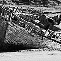 boat wreck on bunbeg beach in gweedore gaeltacht county Donegal Republic of Ireland by Joe Fox