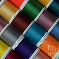 Bright Colored Spools Of Thread by Jim Corwin