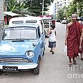 Buddhist Monks In Yangon Street Myanmar by Jacek Malipan
