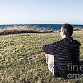 Caucasian Traveler Relaxing On Grass Outdoors by Jorgo Photography - Wall Art Gallery