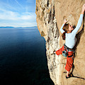 Climber Grabs A Hold While Climbing by Corey Rich
