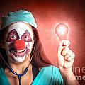 Clown Doctor Holding Red Emergency Lightbulb by Jorgo Photography - Wall Art Gallery