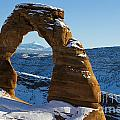 Delicate Arch With Snow Arches National Park Utah by Jason O Watson