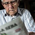 Elderly Man Reading A Newspaper by Mauro Fermariello