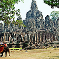 Elephant Ride At The Bayon, Angkor Wat by John W Banagan