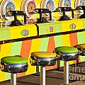 Evergreen State Fair Midway Game With Coloful Stools And Squirt  by Jim Corwin