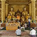 faithful Buddhists praying at Buddha Statues in SHWEDAGON PAGODA by Juergen Ritterbach