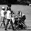Family Walking In The Park by Giuseppe Ridino
