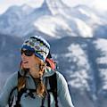 Female Backcountry Skier Skinning by Heath Korvola