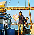 Fisherman With A Skate On Thu Bon River In Hoi An-vietnam  by Ruth Hager