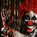 Frightening Clown Doctor Holding Amputated Hand  by Jorgo Photography - Wall Art Gallery