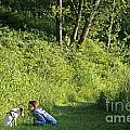 Girl And Dog On Trail by Jim Corwin