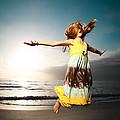 Girl Jumping And Dancing On Beautiful Beach. by Yaromir Mlynski