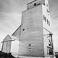 grain elevator and old train track landmark leader Saskatchewan Canada by Joe Fox