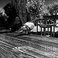 Hungry Pigeon At Mcdonalds Bw by Yousif Hadaya