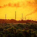 Industrial Chimney Stacks In Natural Landscape Polluting The Air by Matthew Gibson
