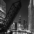 Kinzie Street Railroad Bridge At Night In Black And White by Sebastian Musial