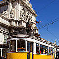 Lisbon's Typical Yellow Tram In Commerce Square by Jose Elias - Sofia Pereira