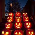 Lit Pumpkins With Demon On Halloween by Jim Corwin