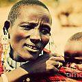 Maasai Baby Carried By His Mother In Tanzania by Michal Bednarek