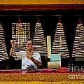 Man Lighting Incense In Chinese Temple Vietnam by Jacek Malipan