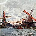 Mills At Westzijderveld Near Zaandam by Claude Monet