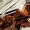 Old Film Strip And Photos Background by Michal Bednarek