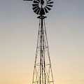 Old Windmill At Sunset Near New by Chuck Haney