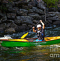 Paddler In A Whitewater Canoe by Les Palenik
