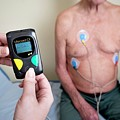 Portable Ecg Monitor Being Fitted by Aberration Films Ltd/science Photo Library