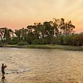 Reid Sabin Fly Fishing At Sunrise by Chuck Haney