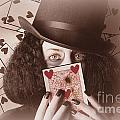 Retro Magician Holding Burnt Playing Card by Jorgo Photography - Wall Art Gallery