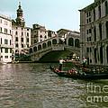 Rialto Bridge In The Grand Canal by Bob Phillips