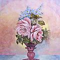 Roses In Ruby Vase by Chuck Adams