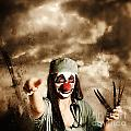 Scary Clown Doctor Throwing Knives Outdoors by Jorgo Photography - Wall Art Gallery
