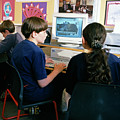 Schoolchildren Working by Martin Riedl/science Photo Library