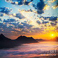 Sea Of Clouds On Sunrise With Ray Lighting by Setsiri Silapasuwanchai