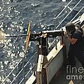Seaman Fires A .50-caliber Machine Gun by Stocktrek Images