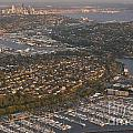 Seattle Skyline With Shilshole Marina Along The Puget Sound  by Jim Corwin
